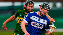 John Lennon of Laois attempts to get away from Kerry's Darren Dineen during their Leinster SHC clash in Tralee. Photo: Ray McManus/Sportsfile