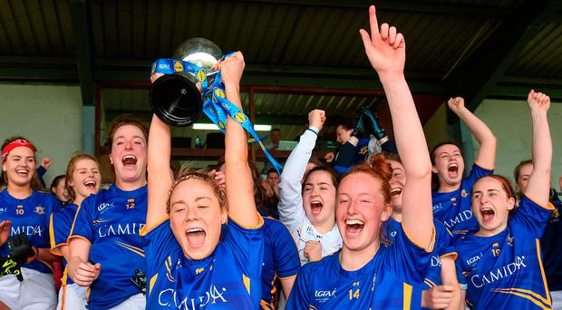 Samantha Lambert captain of Tipperary lifts the cup after the Lidl National Football League Division 3 Final Replay. Photo by Matt Browne/Sportsfile