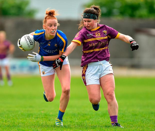 Aisling Moloney of Tipperary in action against Niamh Mernagh of Wexford. Photo: Matt Browne/Sportsfile