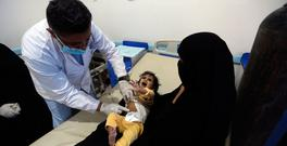 A Yemeni child, suspected of being infected with cholera, receives treatment at a hospital in Sanaa