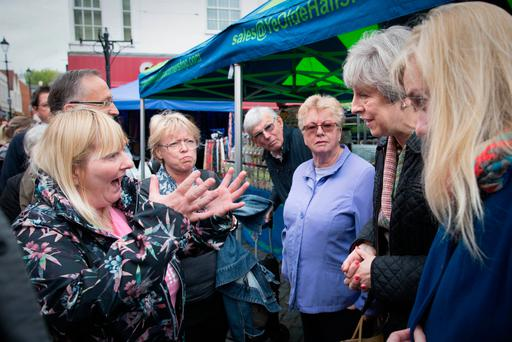 Prime Minister Theresa May meets Cathy Mohan at Abingdon market in Oxfordshire during an General Election campaign visit Photo: Stefan Rousseau/PA Wire