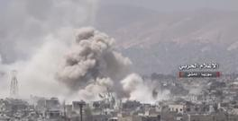 A still image taken from a video uploaded by the Syrian Army on May 13, 2017 shows smoke rising from Qaboun, on the edge of the capital Damascus