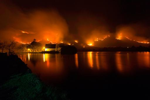 A fire rages close to the church Gougane Barra in county Cork last month. Photo: John Delea.