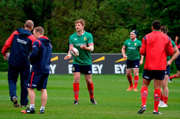 Iain Henderson passes the ball during a training session