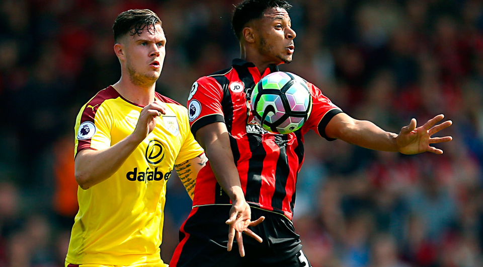 Burnley's Kevin Long challenges Bournemouth's Lys Mousset last Saturday. Photo: PA