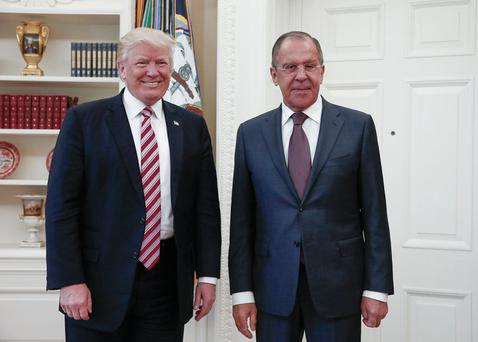 President Donald Trump meets with Russian Foreign Minister Sergey Lavrov, right, at the White House in Washington, Wednesday, May 10, 2017. President Donald Trump on Wednesday welcomed Vladimir Putin's top diplomat to the White House for Trump's highest level face-to-face contact with a Russian government official since he took office in January. Photo: Russian Foreign Ministry Photo via AP