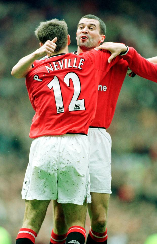 Phil Neville and Roy Keane