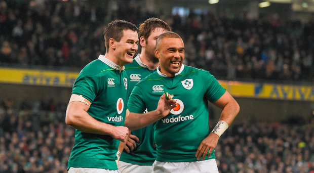 Jonathan Sexton, left, and Simon Zebo of Ireland celebrate after the RBS Six Nations Rugby Championship match between Ireland and England at the Aviva Stadium
