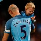 Manchester City's Pablo Zabaleta with his son after the match. His final game for the club at the Etihad