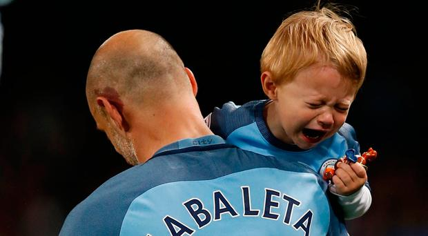 Pablo Zabaleta brings his son onto the pitch for a farewell to the Etihad Stadium. Photo: Reuters