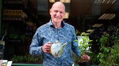 Thomas Querney with a tea plant outside his shop Mr Middleton on Mary Street in Dublin. Photo: Tony Gavin