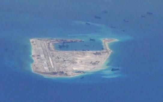 Chinese dredging vessels are purportedly seen in the waters around Fiery Cross Reef in the disputed Spratly Islands in the South China Sea in this still image from video taken by a P-8A Poseidon surveillance aircraft provided by the United States Navy May 21, 2015. U.S. Navy/Handout via Reuters/File Photo