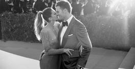 Gisele Bundchen (L) and Tom Brady attend the