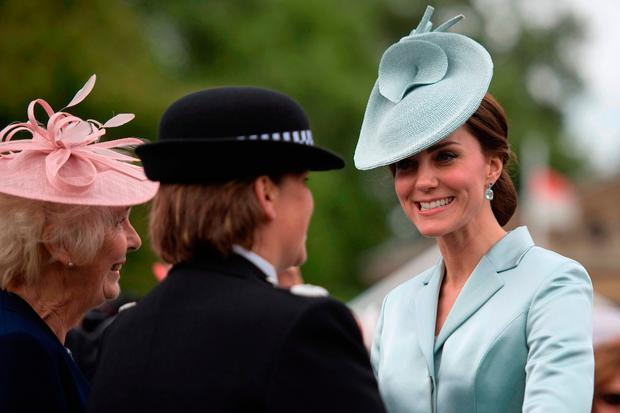 Britain's Catherine, Duchess of Cambridge, (R) greets guests at a garden party at Buckingham Palace in London on May 16, 2017. / AFP PHOTO / POOL / Victoria JonesVICTORIA JONES/AFP/Getty Images