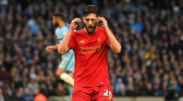MANCHESTER, ENGLAND - MARCH 19: Adam Lallana of Liverpool reacts after missing a chance to score during the Premier League match between Manchester City and Liverpool at Etihad Stadium on March 19, 2017 in Manchester, England. (Photo by Laurence Griffiths/Getty Images)