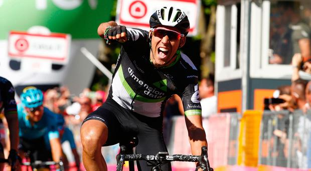 Omar Fraile of Dimension Data punches the air after winning yesterday's stage of the 100th Giro d'Italia. Photo: Luk Benies/Getty