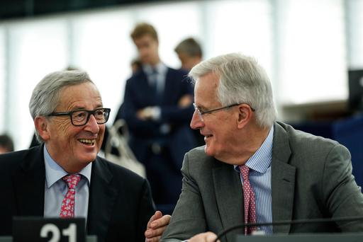 European Union chief Brexit negotiator Michel Barnier (right) listens to European Commission president Jean-Claude Juncker during the European Parliament plenary session in Strasbourg, eastern France, yesterday. Picture: AP