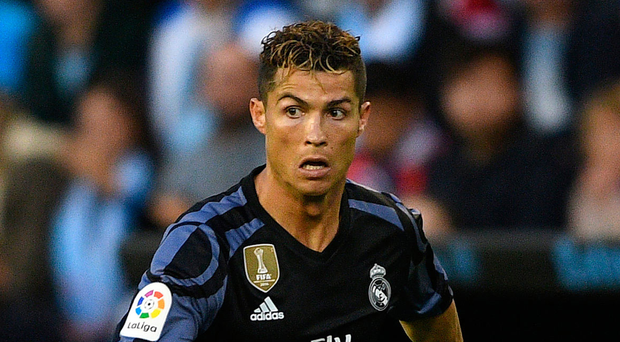 Ronaldo brace edges Real closer to title