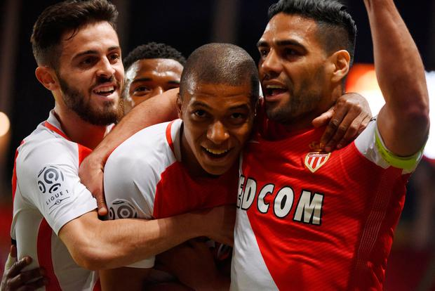 Monaco's Kylian Mbappe celebrates scoring their first goal. Photo: Jean-Pierre Amet/Reuters