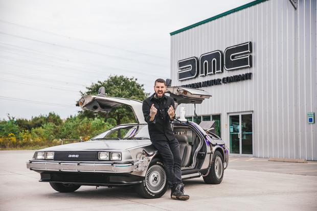 DELOREAN, TEXAS - Shane outside DeLorean with car doors up. (photo credit: National Geographic/Hassan Ghazi)