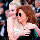 US actresses Elle Fanning (L) and Susan Sarandon pose as they arrive on May 17, 2017 for the screening of the film 'Ismael's Ghosts' (Les Fantomes d'Ismael) during the opening ceremony of the 70th edition of the Cannes Film Festival in Cannes, southern France. / AFP PHOTO / Valery HACHEVALERY HACHE/AFP/Getty Images