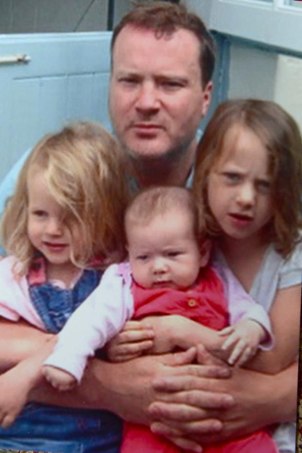 Dr. Paul Devlin with his children, Poppy. Maile and Edie