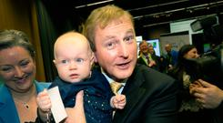 An Taoiseach Enda Kenny holds 7 month old Lexi McKeon from from Rathfarnham at the Healthy Ireland event in Dublin Castle. Photo: Tony Gavin 18/5/2017