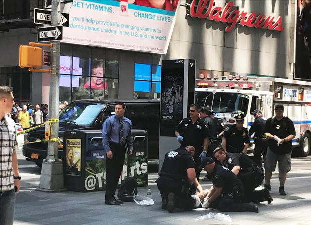 First responders are assisting injured pedestrians after a vehicle struck pedestrians on a sidewalk in Times Square in New York, U.S., May 18, 2017. REUTERS/Jeremy Schultz
