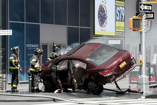 A vehicle that struck pedestrians and later crashed is seen on the footpath in Times Square, New York City Photo: REUTERS/Mike Segar