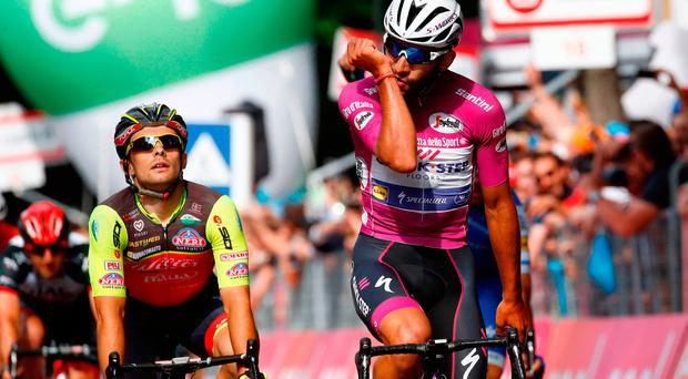 Colombian Fernando Gaviria from QuickStep-Floors crosses the finish line to win the 12th stage of the 100th Giro d'Italia in Reggio Emilia. Photo: AFP/Getty Images