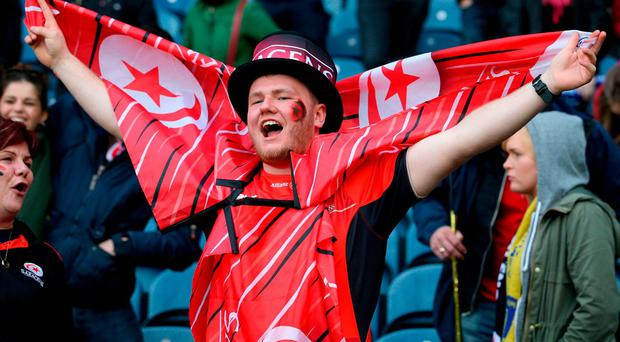 A Sacarens' fan celebrates after his team won the European Champions Cup Final at BT Murrayfield. Photo: Jane Barlow/PA Wire