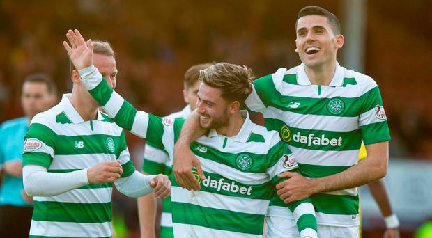 Celtic's Patrick Roberts celebrates scoring his side's third goal of the game