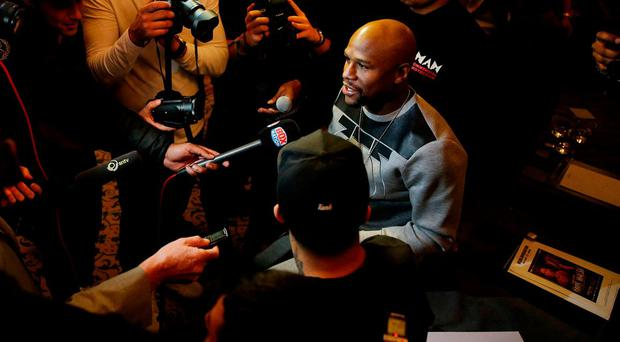 Floyd Mayweather speaks with reporters in London. Photo: Andrew Couldridge/Action Images via Reuters