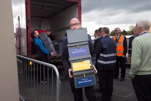 Ballot boxes are carried into the conference centre. Photo: Tony Gavin