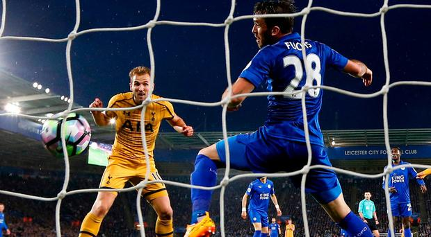 Harry Kane scores his side's third goal during their victory over Leicester last night. Photo: Darren Staples/Reuters