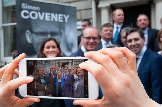 Fine Gael's Simon Coveney with his supporters pose for photos at the launch of his campaign for the Fine Gael leadership at Fine Gael HQ on Mount Street, Dublin. Photo: Gareth Chaney Collins