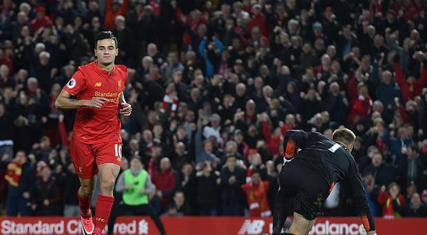 LIVERPOOL, ENGLAND - APRIL 05: (THE SUN OUT, THE SUN ON SUNDAY OUT) Philippe Coutinho of Liverpool celebrates after scoring the first goal during the Premier League match between Liverpool and AFC Bournemouth at Anfield on April 5, 2017 in Liverpool, England. (Photo by Andrew Powell/Liverpool FC via Getty Images)