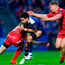 Leinster's Joey Carbery is tackled by Johnny McNicholl, left, and James Davies of Scarlets. Photo: Stephen McCarthy/Sportsfile