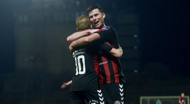 Keith Ward of Bohemians is congratulated by team-mate Dinny Corcoran