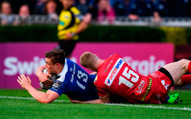 Leinster's Garry Ringrose goes over to score his side's first try despite the attention of Johnny McNicholl. Photo: Stephen McCarthy/Sportsfile