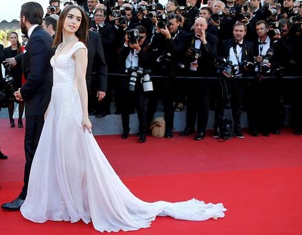 Actress Lily Collins poses during the photo call for the film 'Okja' at the 70th Cannes Film Festival in southern France. Photo: Reuters