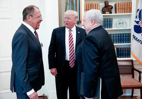 US President Donald Trump speaking with Russian Foreign Minister Sergei Lavrov, left, and Russian Ambassador to the US Sergei Kislyak after firing FBI director James Comey