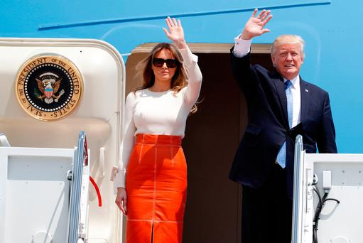 President Donald Trump and first lady Melania Trump, wave as they board Air Force One at Andrews Air Force Base prior to his departure on his first overseas trip. Photo: AP