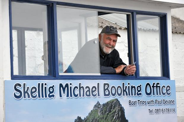 Butch Roberts selling tickets on the opening day of the Skellig Rocks trip in Portmagee, County Kerry on Friday. Photo: Don MacMonagle