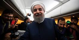 Iranian President and presidential candidate, Hassan Rouhani, speaks with reporters and photographers, who covered his campaign rallies, during a flight from northeastern city of Mashhad to Tehran late on May 17, 2017.(Photo credit: BEHROUZ MEHRI/AFP/Getty Images)