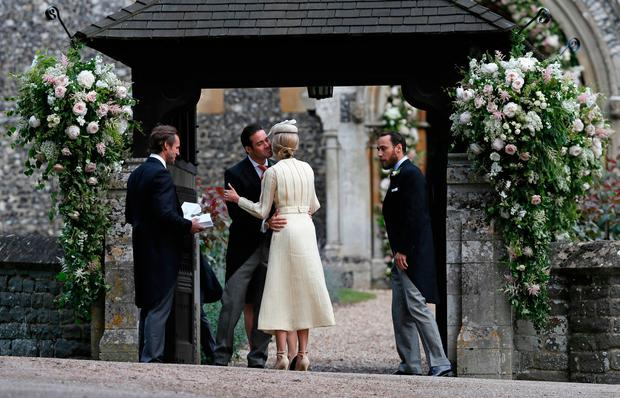 Spencer Matthews, second left, is greeted by Donna Air as her partner James Middleton (right) looks on, prior to the wedding of Pippa Middleton to millionaire groom James Matthews at an event dubbed the society wedding of the year. PRESS ASSOCIATION Photo. Picture date: Saturday May 20, 2017. See PA story ROYAL Pippa. Photo credit should read: Kirsty Wigglesworth/PA Wire