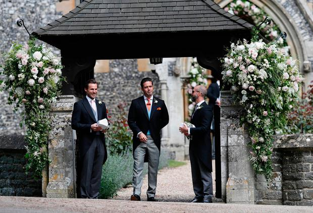 Spencer Matthews (centre), the brother of groom James Matthews, stands at the entrance of St Mark's Church in Englefield, ahead of his brother's wedding to Pippa Middleton. Pic: Kirsty Wigglesworth/PA Wire