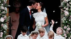 Prince George (second right) leaves with other page boys and flower girls following the wedding of Pippa Middleton and her husband James Matthews at St Mark's church in Englefield, Berkshire.
