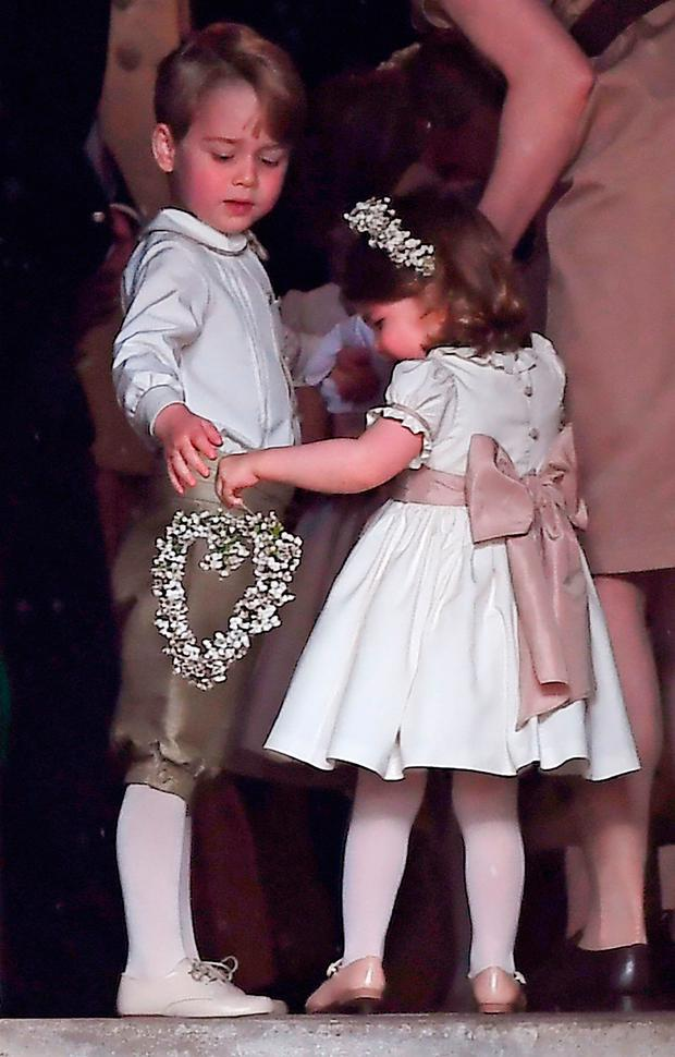 Prince George and Princess Charlotte at the wedding of the Duchess of Cambridge's sister Pippa Middleton to her millionaire groom James Matthews, dubbed the society wedding of the year at, St Mark's church in Englefield, Berkshire