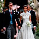 Pippa Middleton (R) and her new husband James Matthews leave St Mark's Church in Englefield, west of London, on May 20, 2017 following their wedding ceremony.